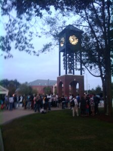 students gather at the bell tower for the take back the night rally